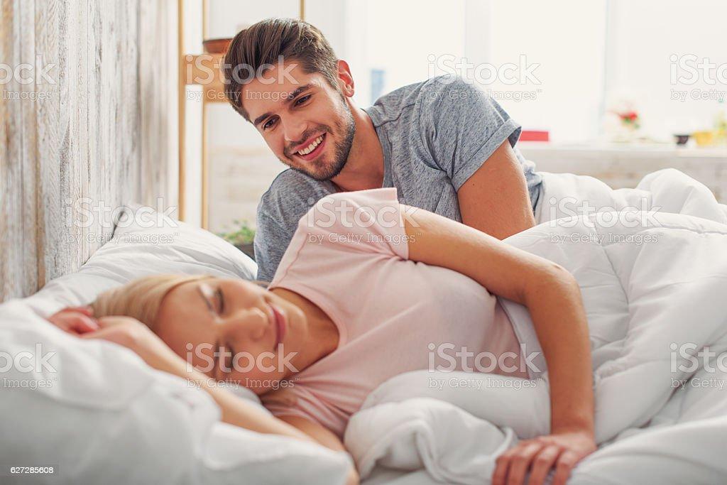 Happy man watching her wife sleeping stock photo