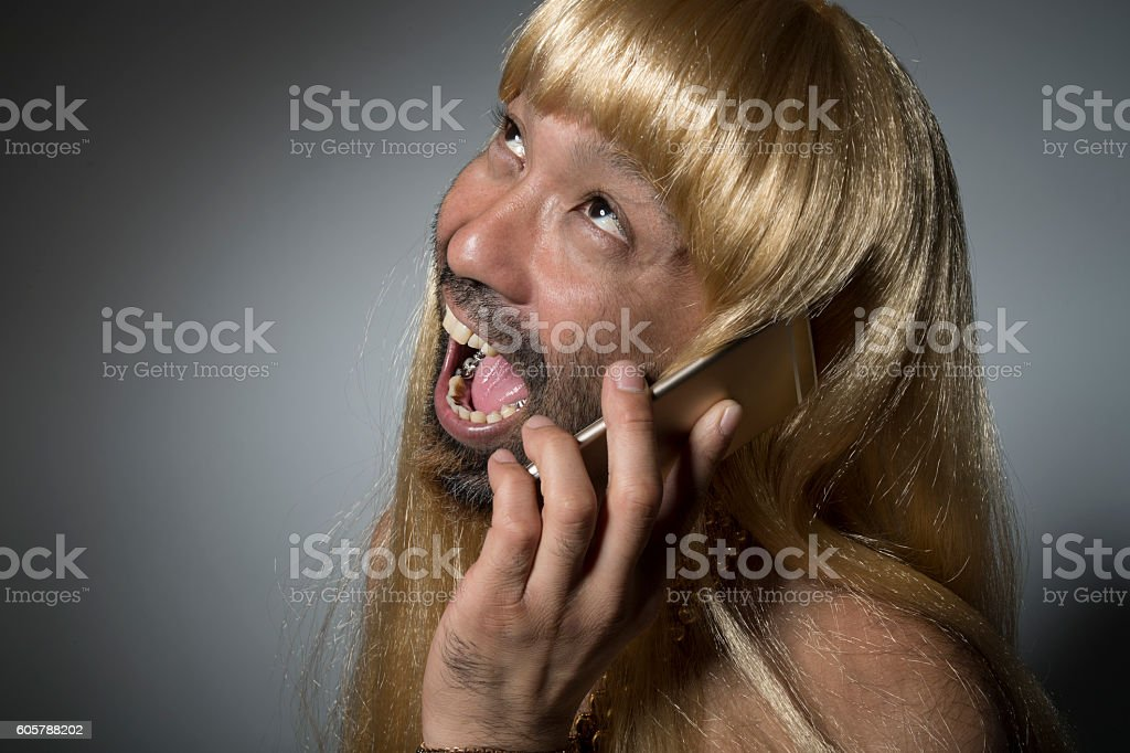 Happy man wearing a wig of blond hair. stock photo