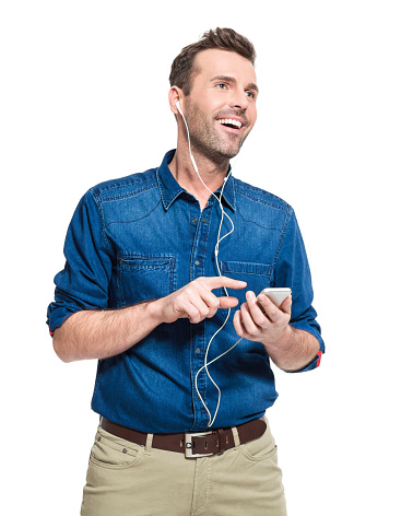 Happy Man Wearing Earphone Holding Smart Phone Stock Photo - Download Image Now