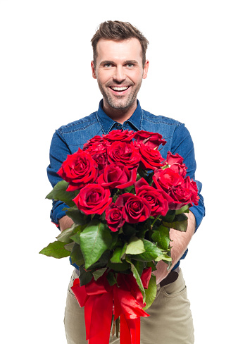 Happy Man Wearing Jeans Shirt Holding Bouquet Of Red Roses Stock Photo - Download Image Now