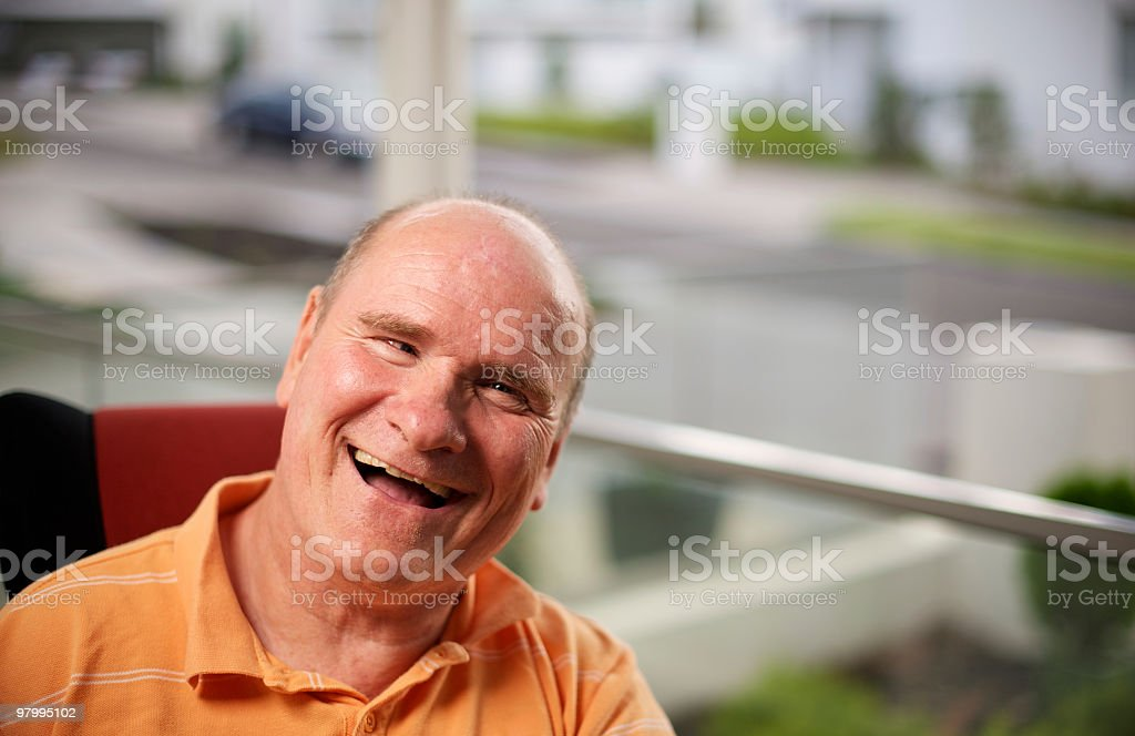 Happy man with a disability on his front porch stock photo