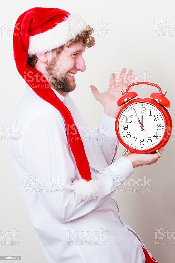 Happy man with alarm clock. Christmas time. stock photo