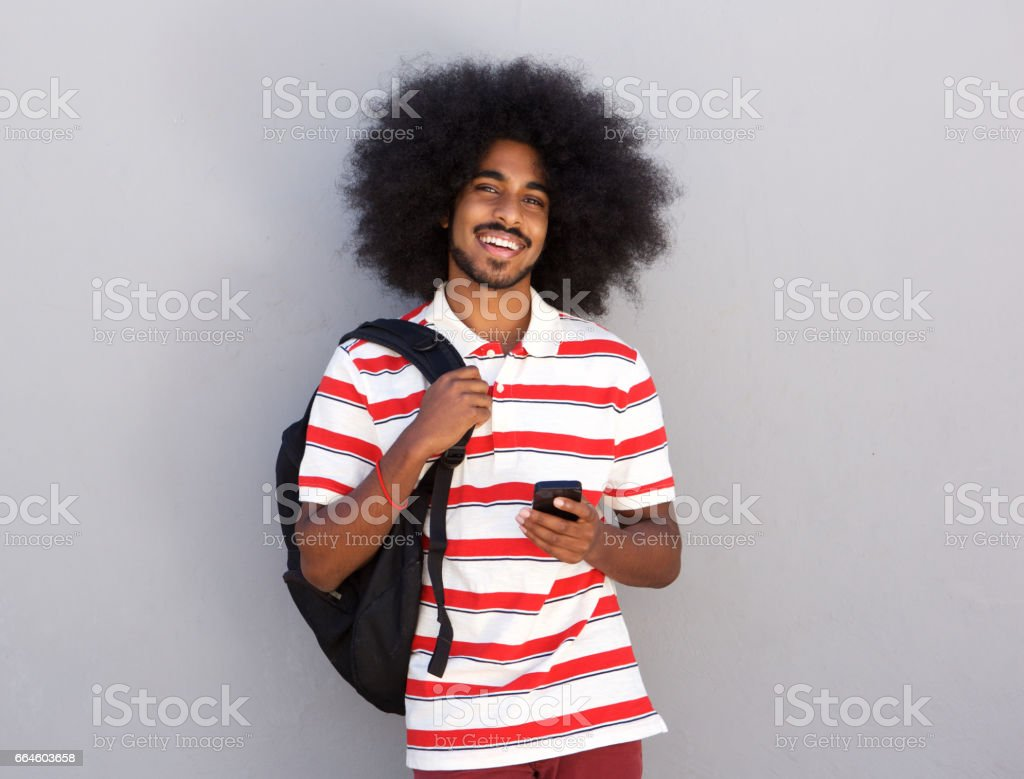 happy man with backpack and mobile phone stock photo