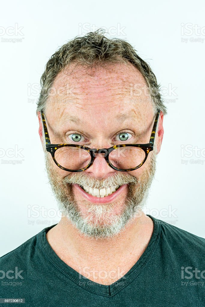 Happy man with beard and glasses laughing, funny portrait. royalty-free stock photo