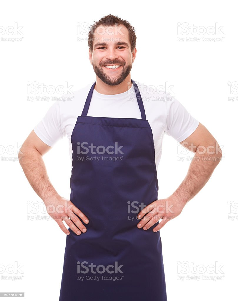Happy man with blue apron stock photo