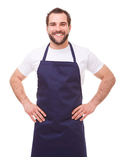 happy man with blue apron - apron stock pictures, royalty-free photos & images