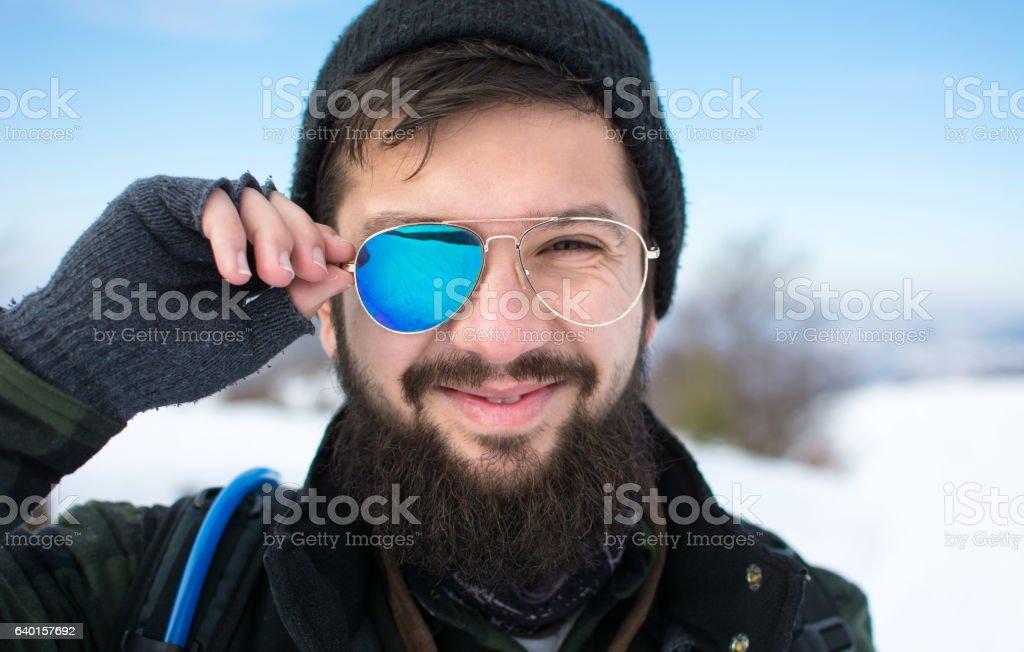 Happy man with broken sunglasses stock photo