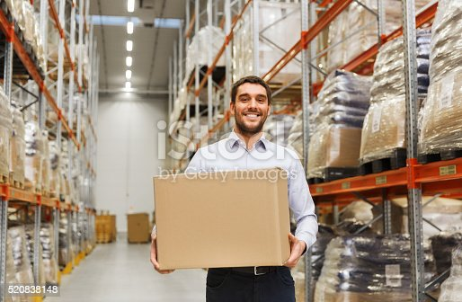 istock happy man with cardboard parcel box at warehouse 520838148