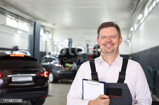 962888586 istock photo Happy man with checklist paper 1215821030