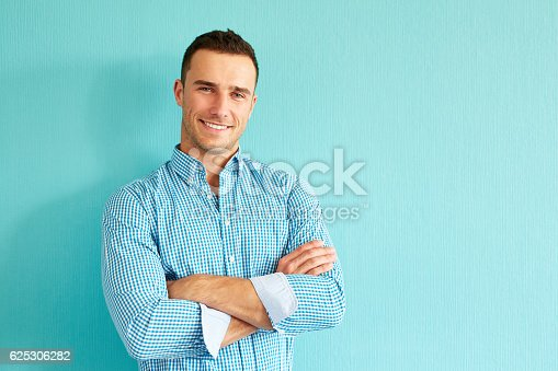istock Happy man with crossed arms 625306282