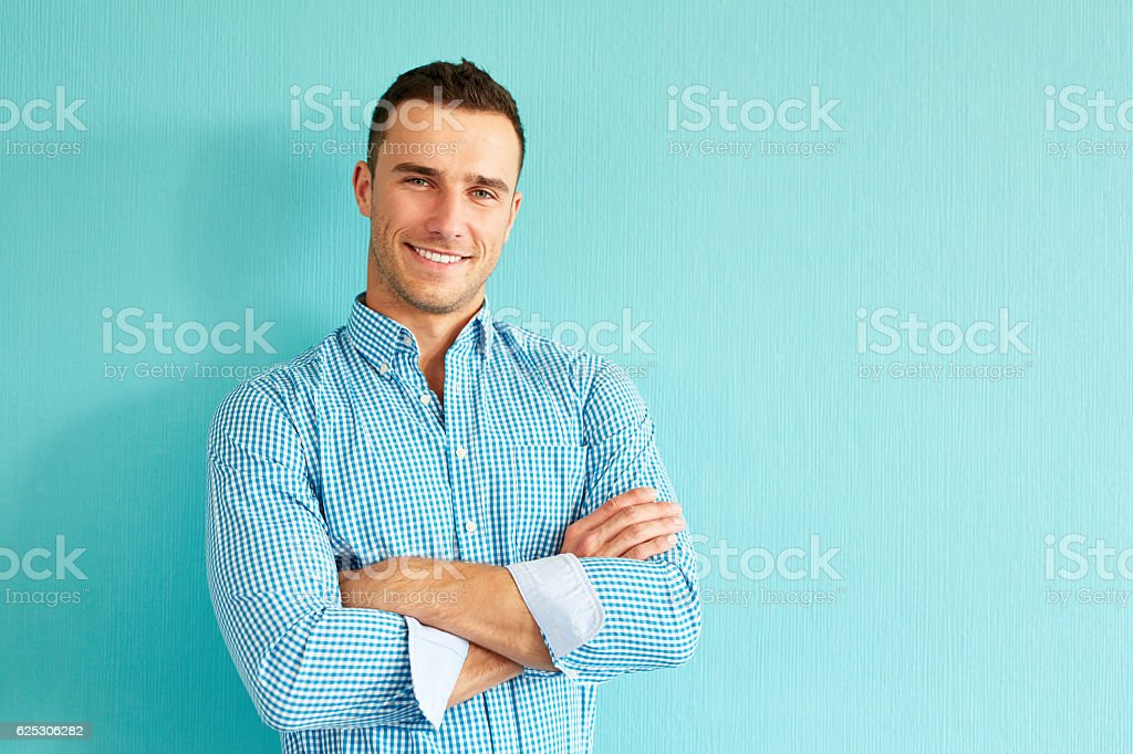 Happy man with crossed arms stock photo