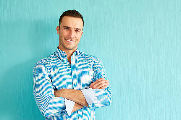happy man with crossed arms - handsome people stock photos and pictures
