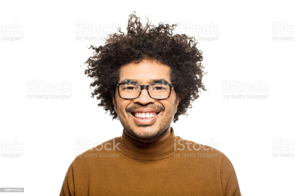 Happy man with eyeglasses and curly hair stock photo