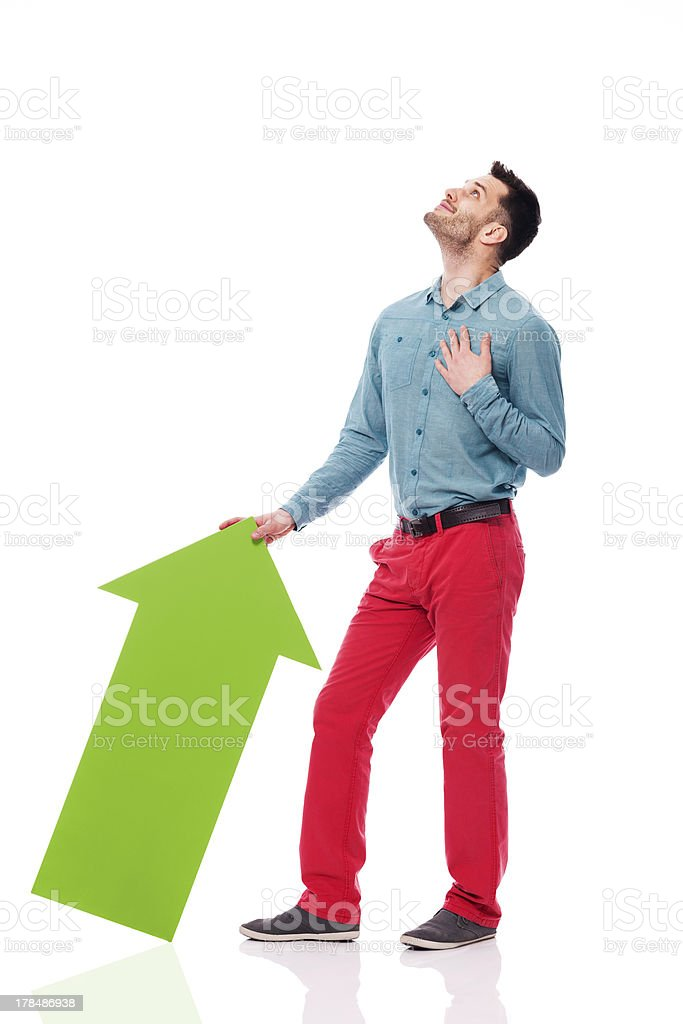 Happy man with green arrow looking up royalty-free stock photo