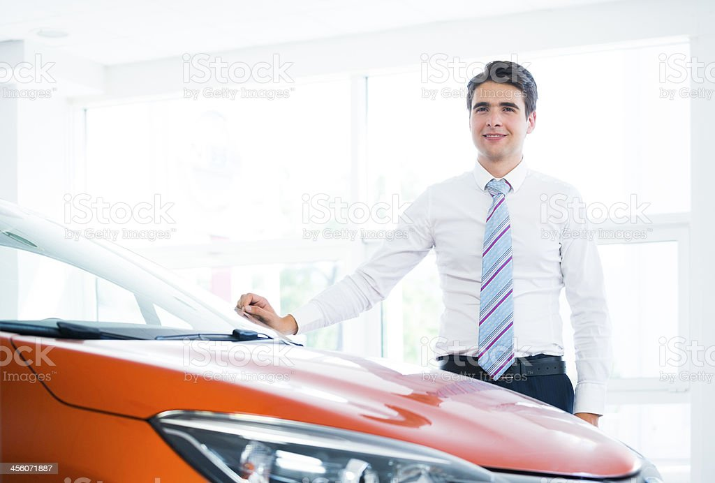 Happy man with his new car royalty-free stock photo
