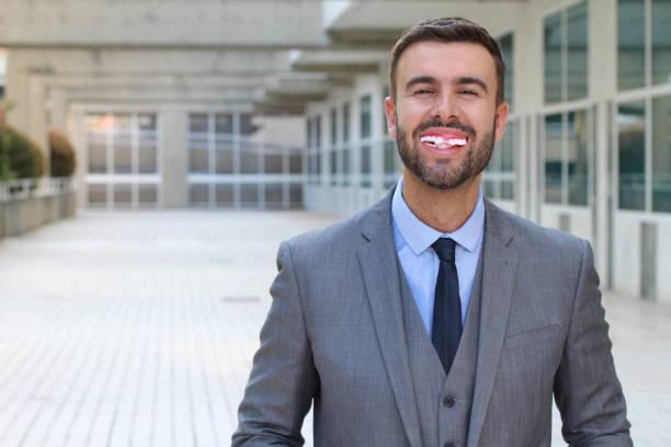Happy man with horrible teeth stock photo