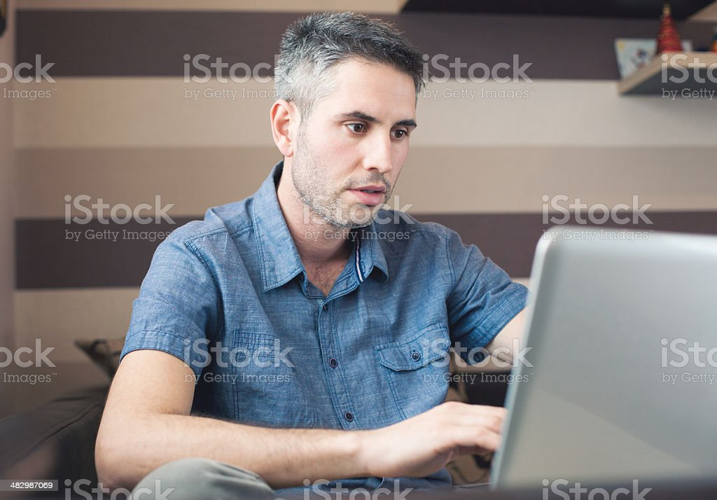 Happy man with laptop royalty-free stock photo