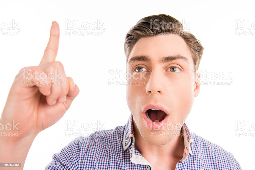 Happy man with open mouth having an idea and pointing up royalty-free stock photo
