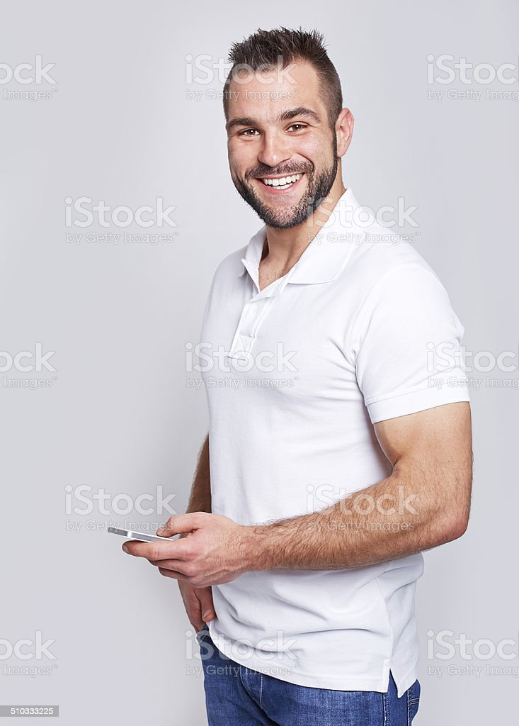 Happy man with phone in hand stock photo