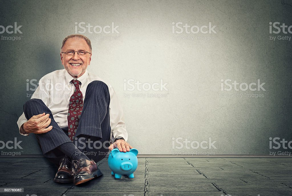 Happy man with piggy bank stock photo