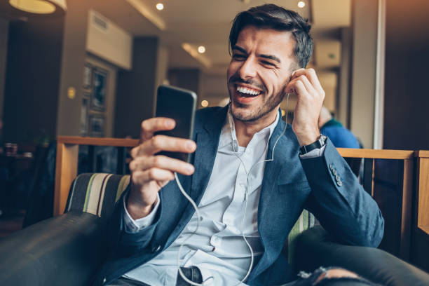 Happy man with smart phone stock photo