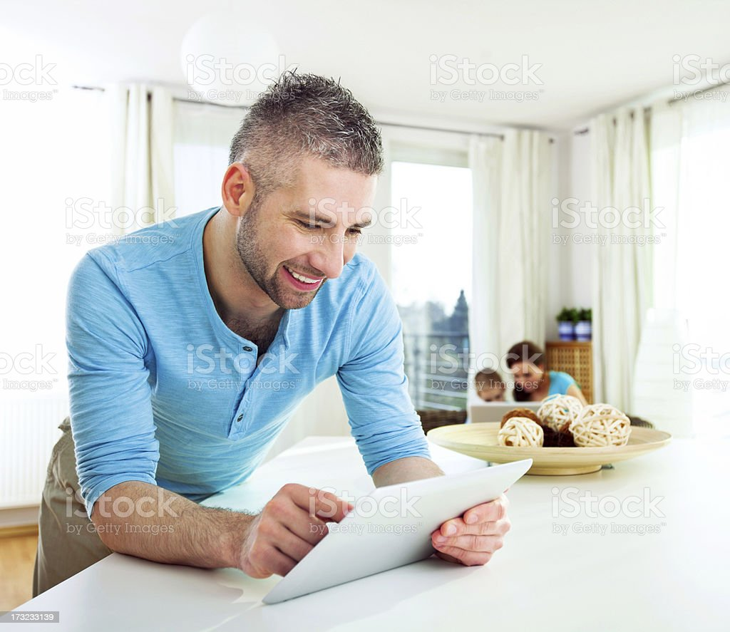 Happy Man with Tablet at Home royalty-free stock photo