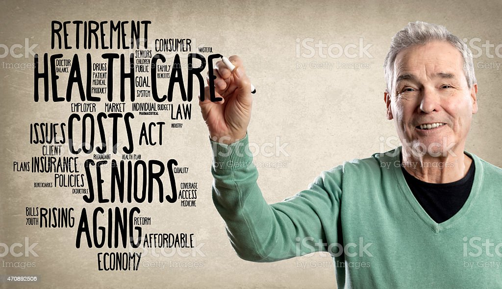 Happy Man, Writing with a Marker - Health Care Word stock photo