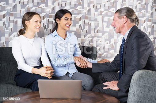 istock Happy Manager and Women Couple Shaking Hands 640186430