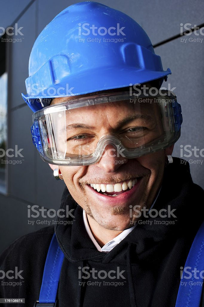 Happy Manual Worker In Blue Hardhat royalty-free stock photo