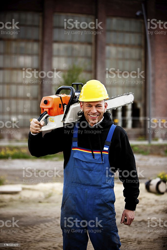 Happy Manual Worker With Electric Saw, Portrait royalty-free stock photo