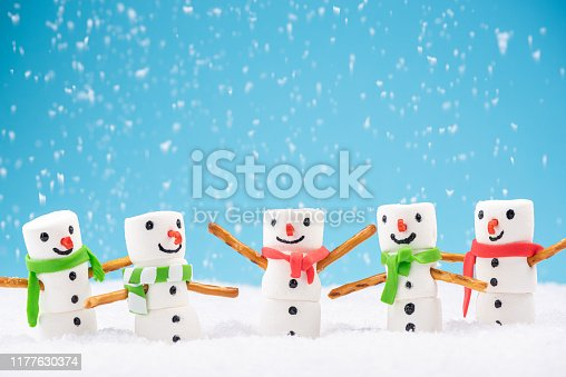 Happy Marshmallow Family Play in Snow. Funny Festive Christmas Card.