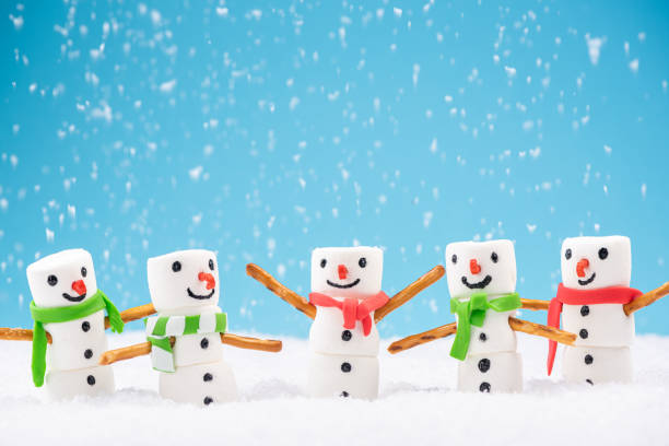 Happy Marshmallow Family Play in Snow. Funny Festive Christmas Card Happy Marshmallow Family Play in Snow. Funny Festive Christmas Card. snowman stock pictures, royalty-free photos & images