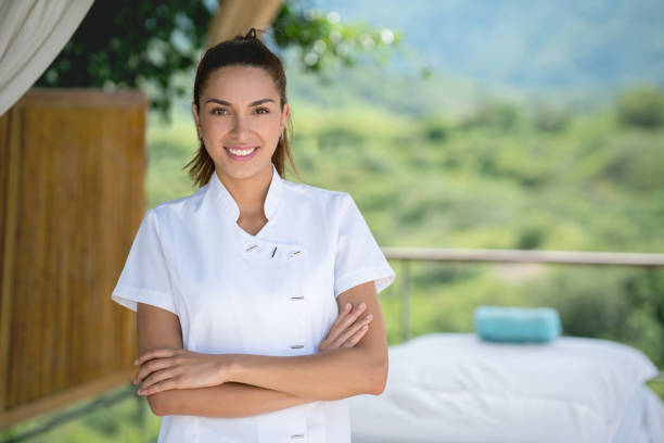 happy masseuse working at an outdoor spa - beautician stock photos and pictures