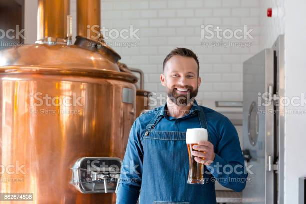Happy Master Brewer Holding Beer Glass In His Micro Brewery Stock Photo - Download Image Now