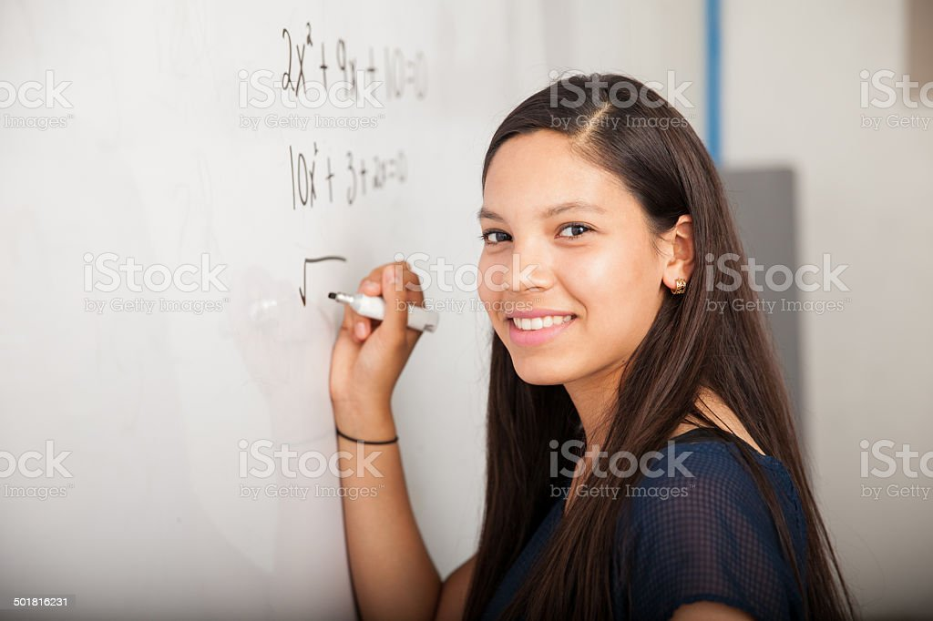 Happy math student in class stock photo