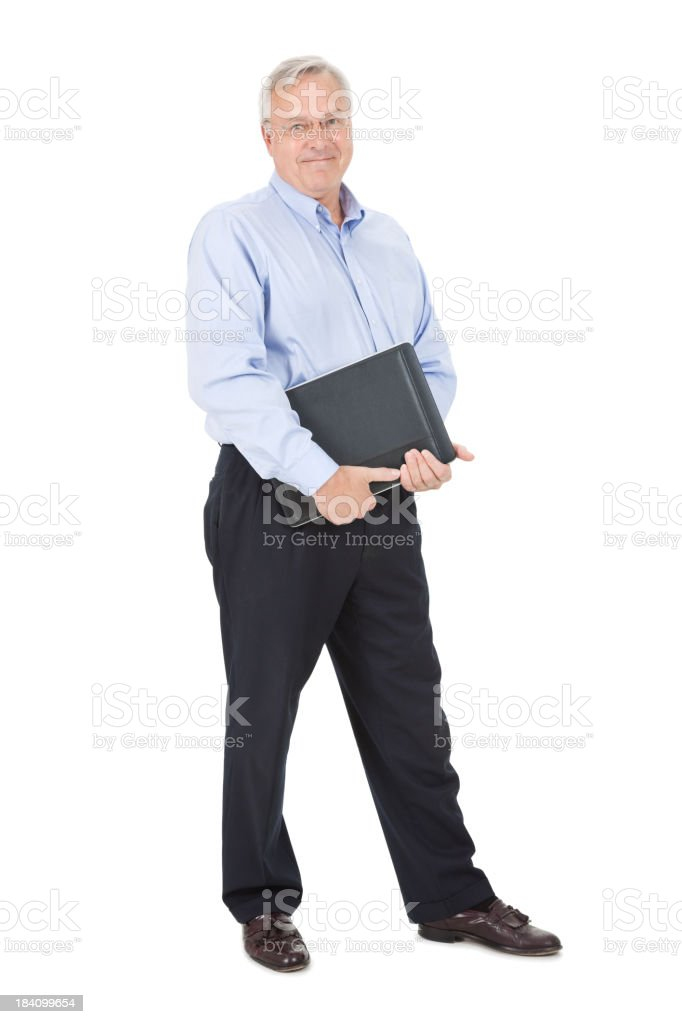 Happy Mature Adult Man With Laptop and Work Binder royalty-free stock photo