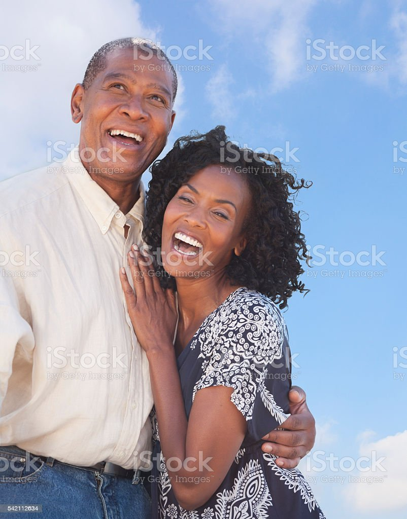 Happy Mature African American couple embracing stock photo