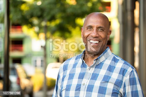 Portrait of a mature African American man smiling.