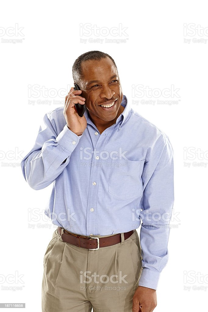Happy mature african man making a phone call stock photo