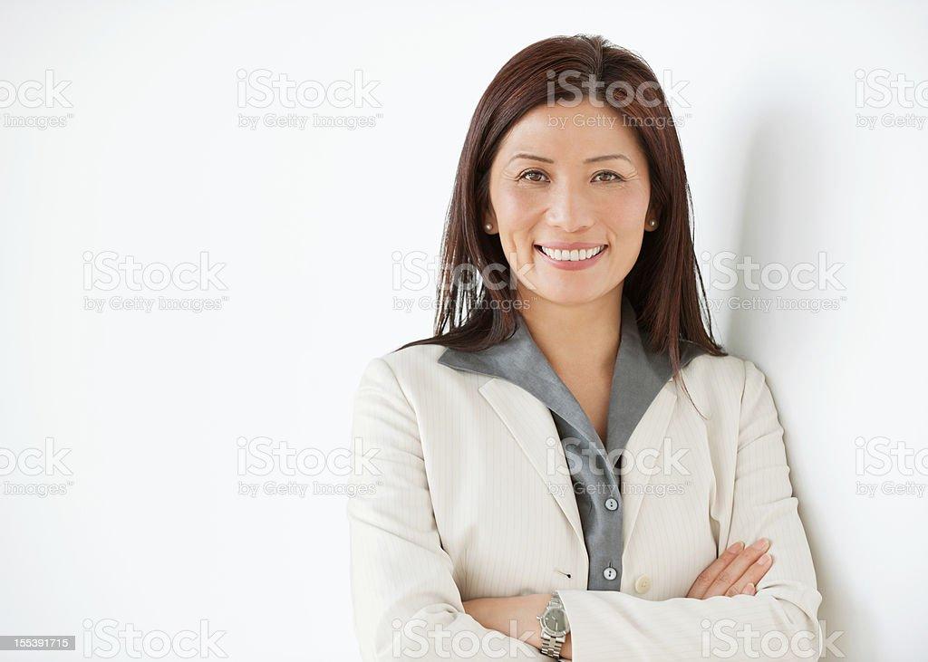 Happy Mature Asian Businesswoman stock photo