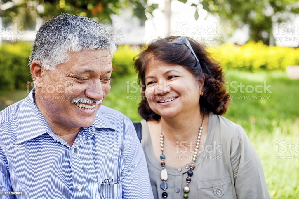 Happy Mature Asian Indian Couple Outdoor Portrait stock photo