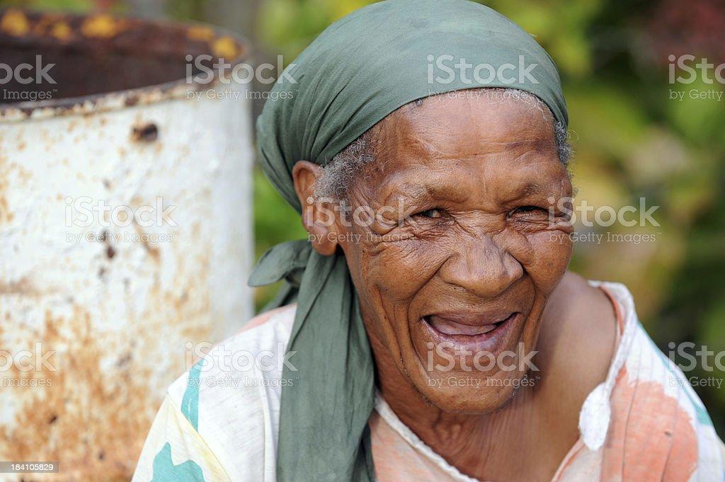 Happy mature black farmworker woman. stock photo