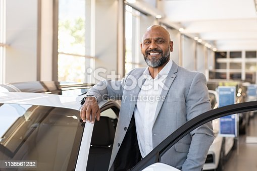 1138561232 istock photo Happy mature black man at car dealership 1138561232