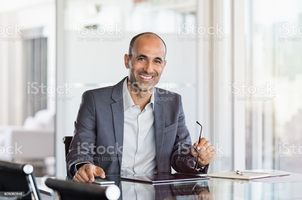 Happy mature business man stock photo