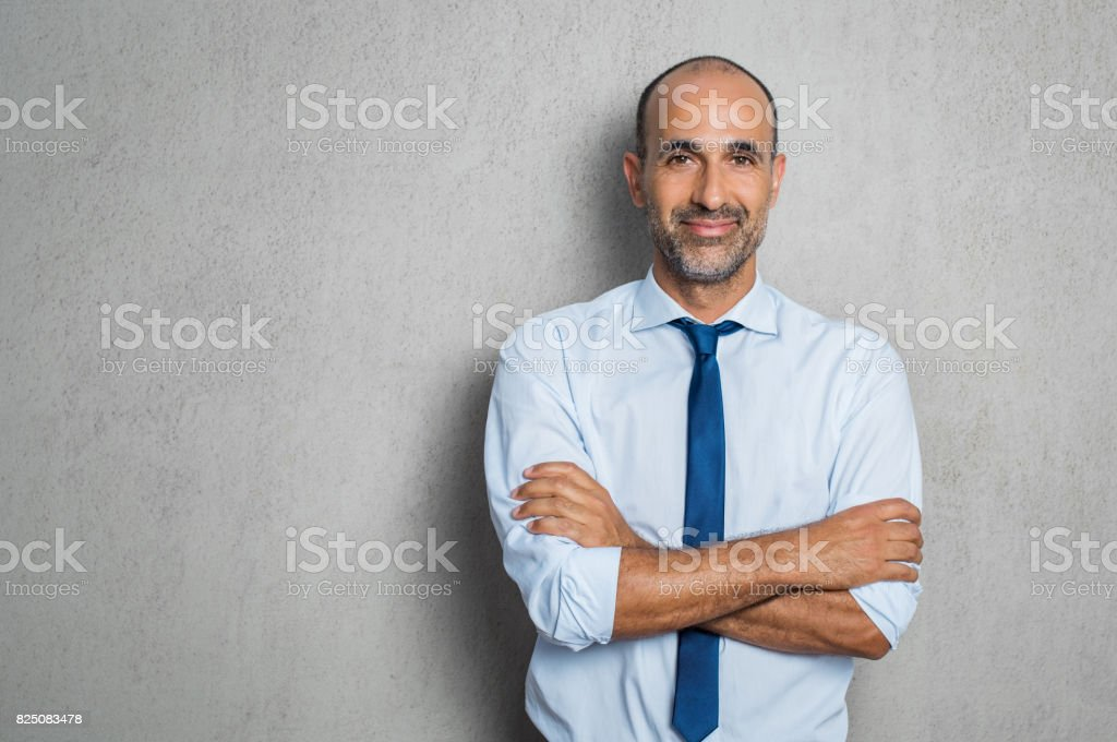 Happy mature businessman stock photo
