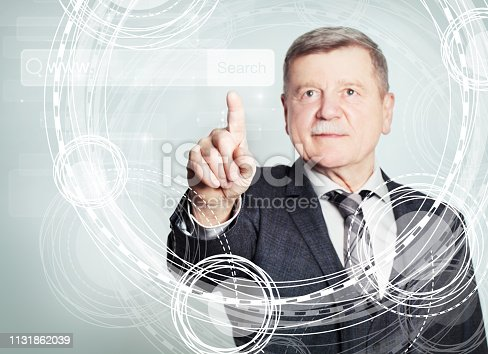 istock Happy mature businessman pointing to empty address bar in virtual web browser 1131862039