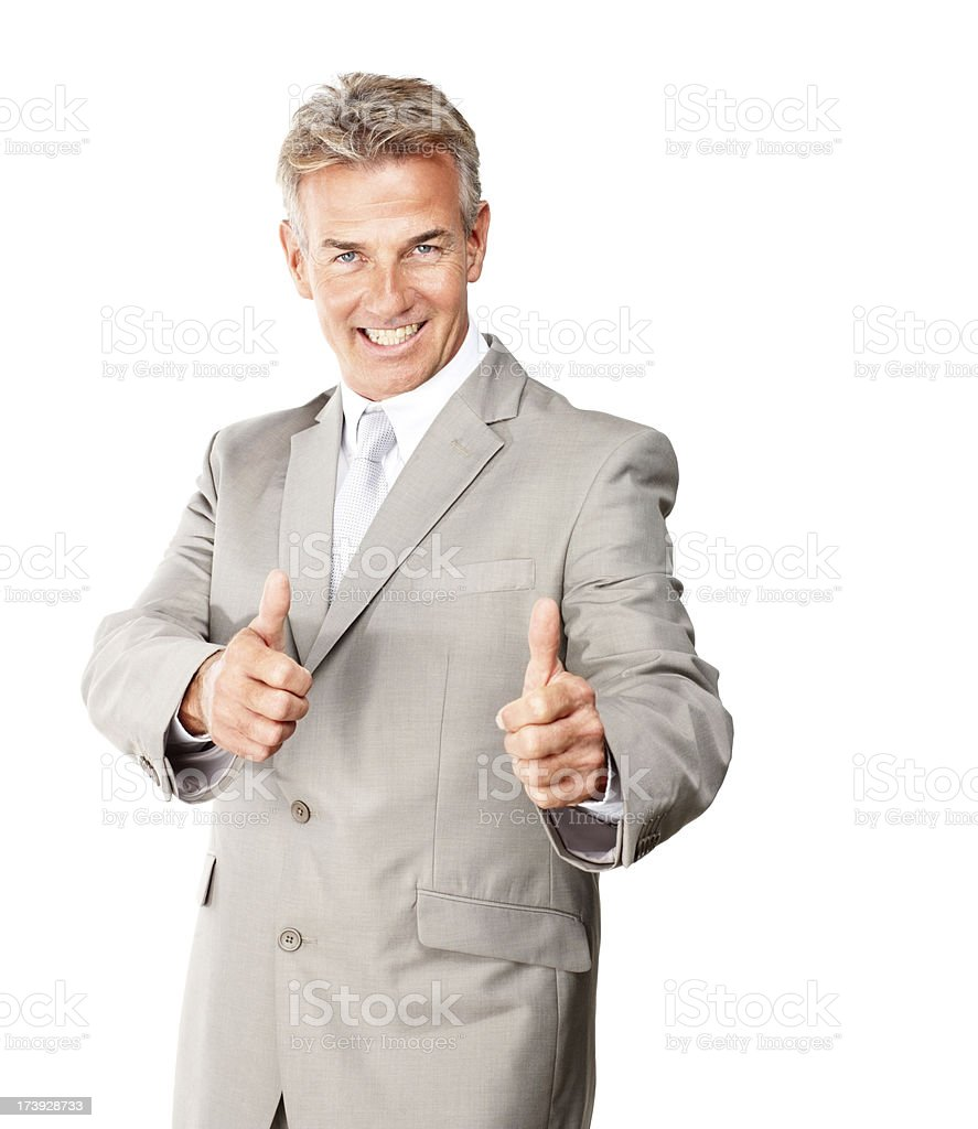 Happy mature businessman showing thumbs up sign royalty-free stock photo