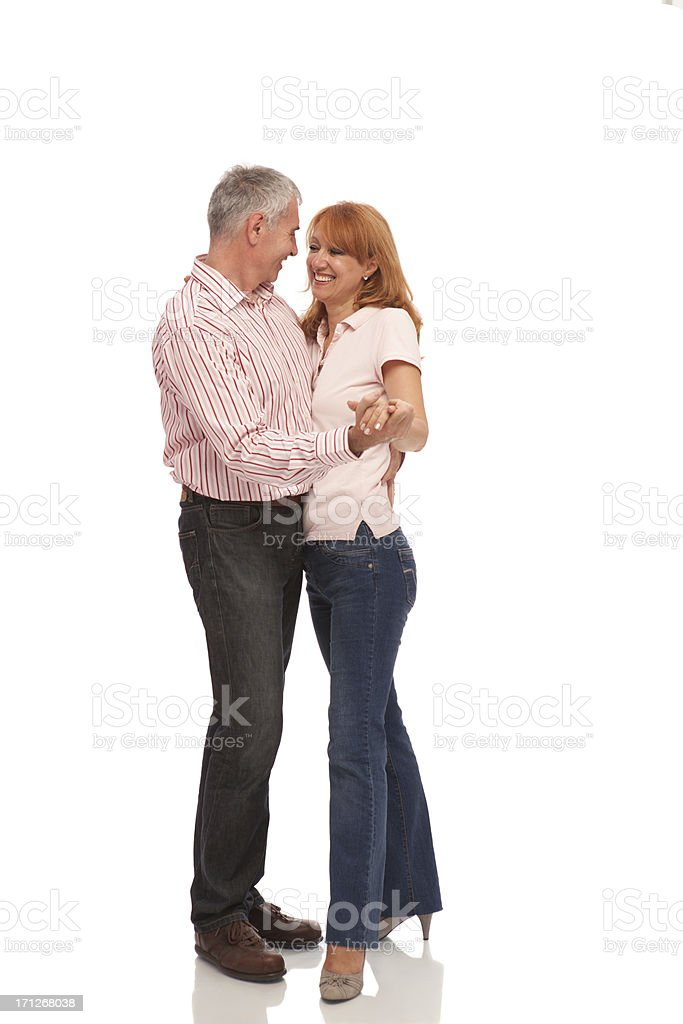 Happy mature couple dancing embraced. royalty-free stock photo