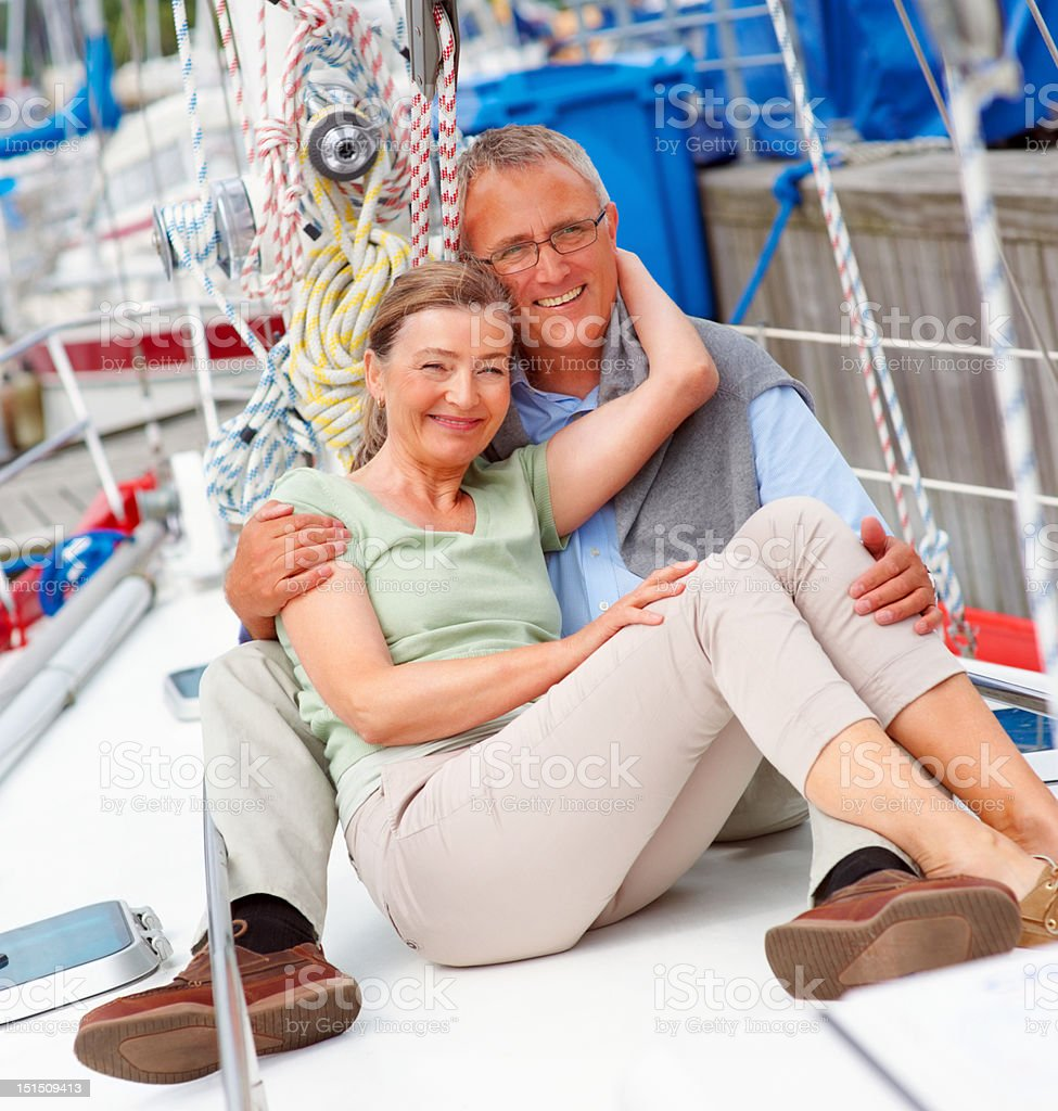 Happy mature couple enjoying vacation on yacht royalty-free stock photo