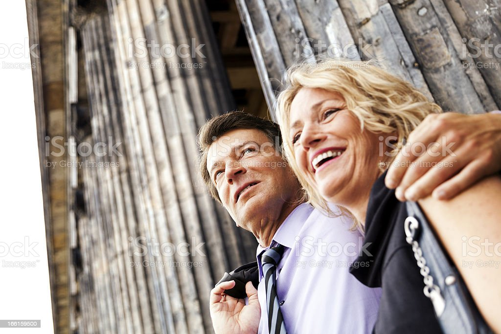 Happy Mature Couple Gazing Portrait with Classic Columns royalty-free stock photo